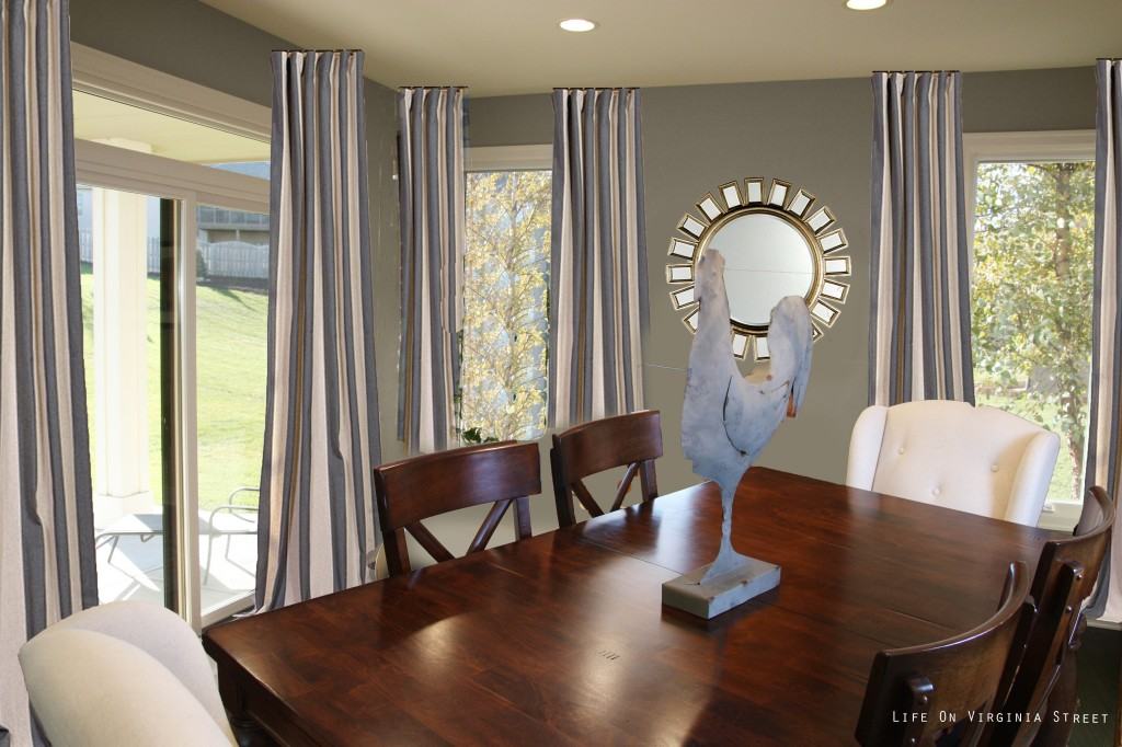 Striped curtains in dining room with a rooster statue on the wooden table.
